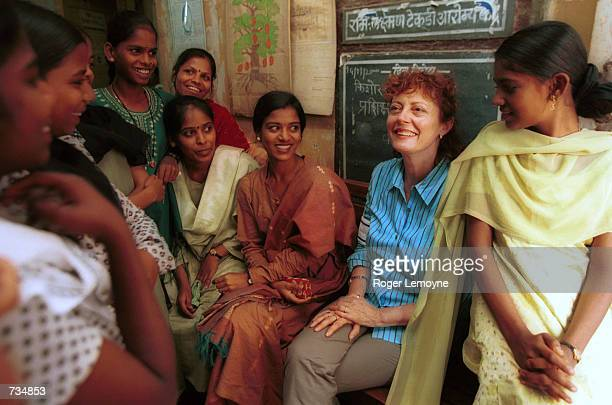 Actress and UNICEF Special Representative Susan Sarandon second from right listens to adolescent girls talk at a health center December 5 2000 in...