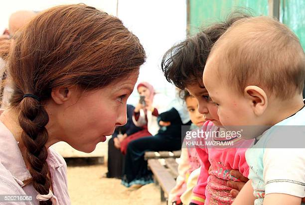 US actress and United Nations Population Fund's Goodwill Ambassador Ashley Judd plays with Syrian children during a visit at the Zaatari refugee camp...
