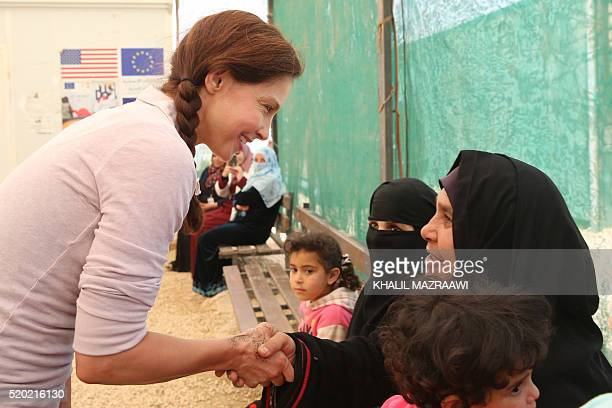 US actress and United Nations Population Fund's Goodwill Ambassador Ashley Judd chats with Syrian refugees during a visit at the Zaatari refugee camp...