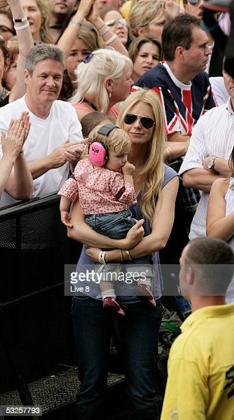 "Actress and wife of Coldplay member Chris Martin, Gwyneth Paltrow, and their daughter Apple attend ""Live 8 London"" in Hyde Park on July 2, 2005 in..."