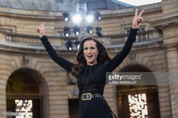 Actress Andie MacDowell flashes victory signs as she presents a creation for L'Oreal during the Women's Spring-Summer 2020 Ready-to-Wear collection...