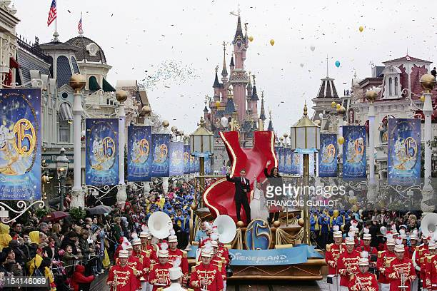 US actress Andie MacDowell on a float salutes the crowd as she parades during the celebrations marking the 15th anniversary of the US theme park...