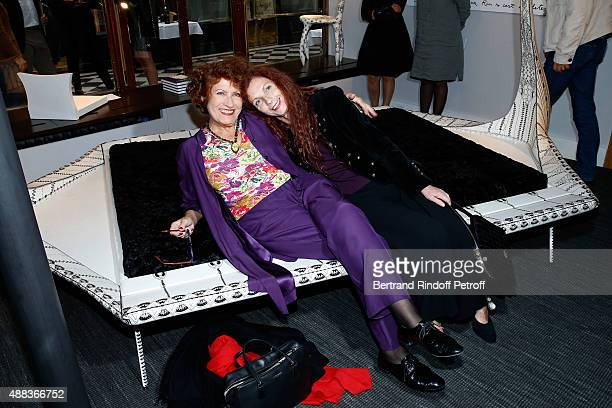 Actress Andrea Ferreol and Artist Chantal Saccomanno sitting on her Work attend the 'Paintings Poems from Tahar Ben Jelloun Furniture Scriptures from...