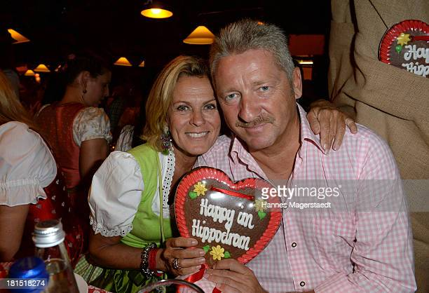 Actress Andrea L'Arrongeand her husband Charly Reichenwallner attend the Oktoberfest beer festival at Theresienwiese on September 21 2013 in Munich...
