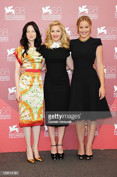 Actress Andrea Riseborough director/writer Madonna and actress Abbie Cornish attend the 'WE' Photocall during the 68th Venice International Film...