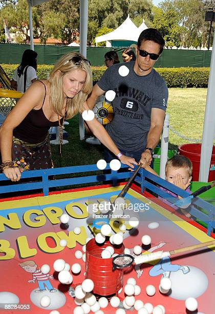 Actress Andrea Roth and actor Mark Wahlberg attend A Time for Heroes Celebrity Carnival Sponsored by Disney benefiting the Elizabeth Glaser Pediatric...