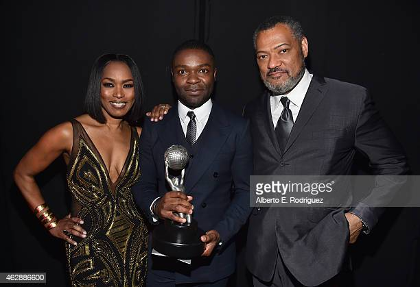 Actress Angela Bassett actor David Oyelowo winner of Outstanding Actor in a Motion Picture for 'Selma' and actor Laurence Fishburne attend the 46th...