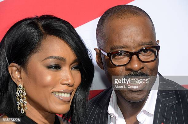 Actress Angela Bassett and actor Courtney B Vance arrive for the Premiere Of Focus Features' London Has Fallen held at ArcLight Cinemas Cinerama Dome...