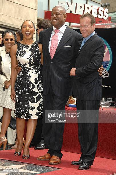 Actress Angela Bassett and actor Kiefer Sutherland with Forest Whitaker at the ceremony honoring him on the Hollywood Walk of Fame
