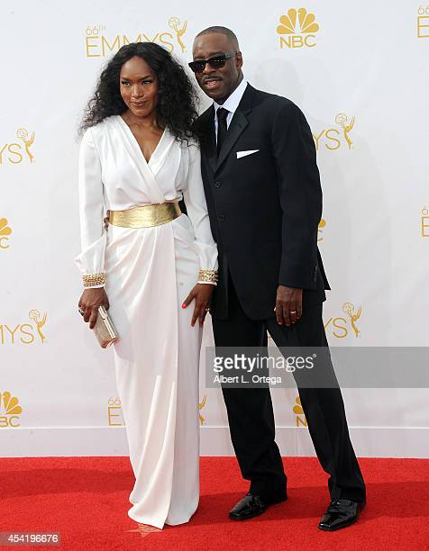 Actress Angela Bassett and actor/husband Courtney B Vance arrive for the 66th Annual Primetime Emmy Awards held at Nokia Theatre LA Live on August 25...