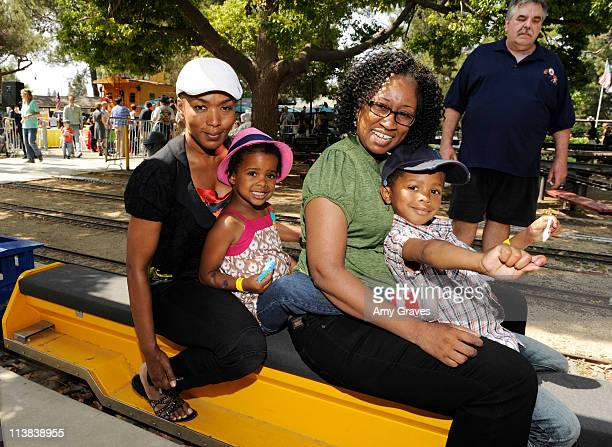 Actress Angela Bassett and children Bronwyn and Slater attend the Jim Henson Company and PBS SoCal Dinosaur Train Event at Los Angeles Live Steamers...
