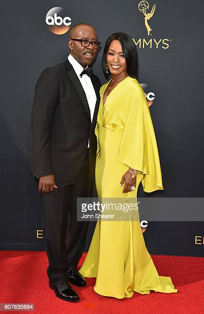 Actress Angela Bassett and Courtney B Vance arrive at the 68th Annual Primetime Emmy Awards at Microsoft Theater on September 18 2016 in Los Angeles...