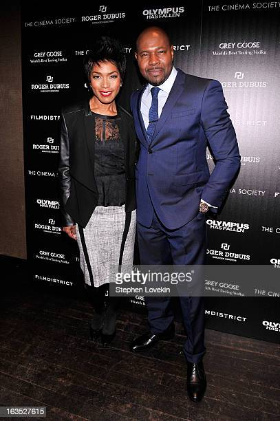 Actress Angela Bassett and director Antoine Fuqua attend The Cinema Society with Roger Dubuis and Grey Goose screening of FilmDistrict's Olympus Has...
