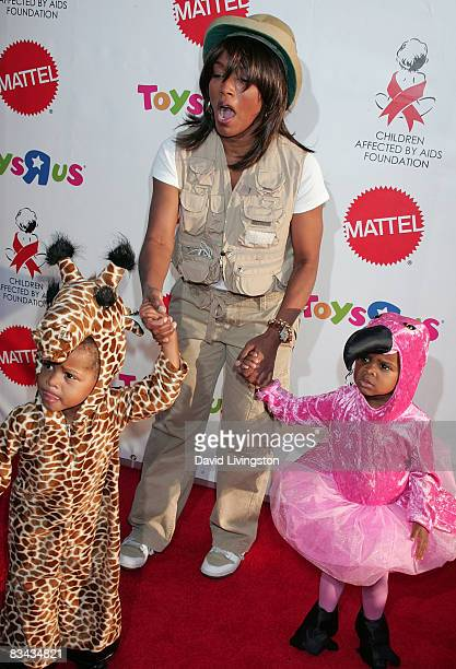 Actress Angela Bassett and her children Slater Vance and Bronwyn Vance attend the AIDS Foundation's 15th annual Dream Halloween benefit at Barker...