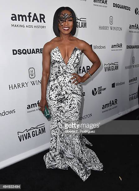 Actress Angela Bassett attends amfAR's Inspiration Gala Los Angeles at Milk Studios on October 29 2015 in Hollywood California