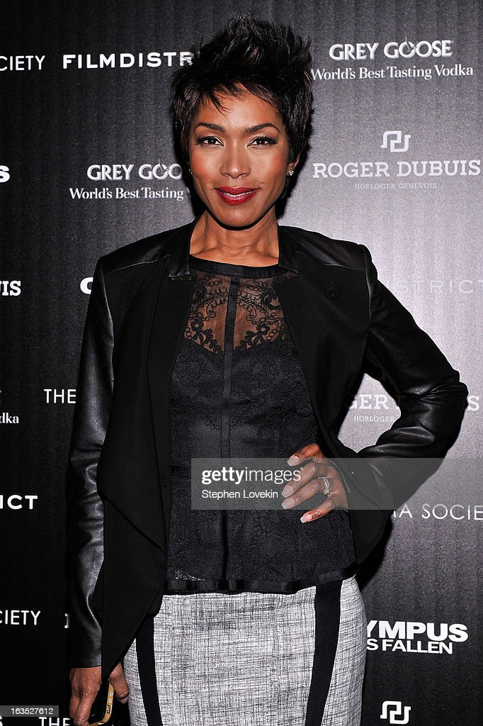 Actress Angela Bassett attends The Cinema Society with Roger Dubuis and Grey Goose screening of FilmDistrict's 'Olympus Has Fallen' at Tribeca Grand Hotel on March 11, 2013 in New York City.