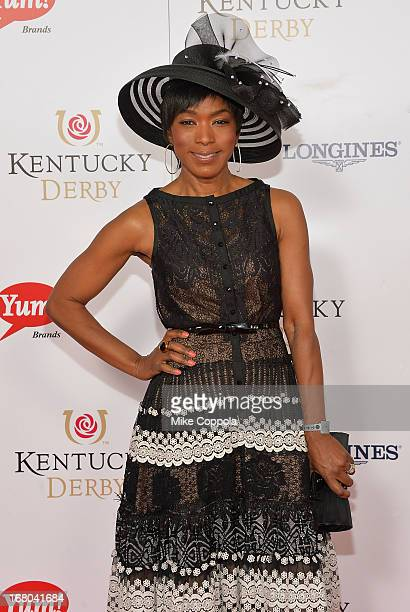Actress Angela Bassett celebrates the 139th Kentucky Derby with Moet Chandon at Churchill Downs on May 4 2013 in Louisville Kentucky