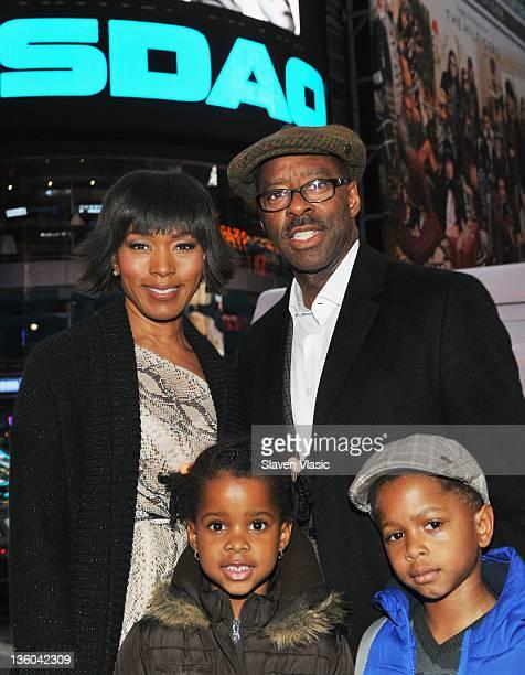 Actress Angela Bassett husband Courtney B Vance children Bronwyn Golden Vance and Slater Josiah Vance attend the NASDAQ stock market closing bell on...