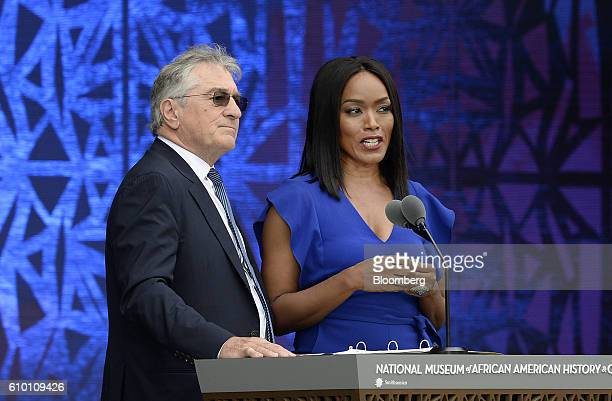 Actress Angela Bassett right speaks as actor Robert De Niro listens at the opening ceremony of the Smithsonian's National Museum of African American...