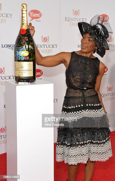 Actress Angela Bassett signs the Moet Chandon 6L for the Churchill Downs Foundation during the 139th Kentucky Derby at Churchill Downs on May 4 2013...