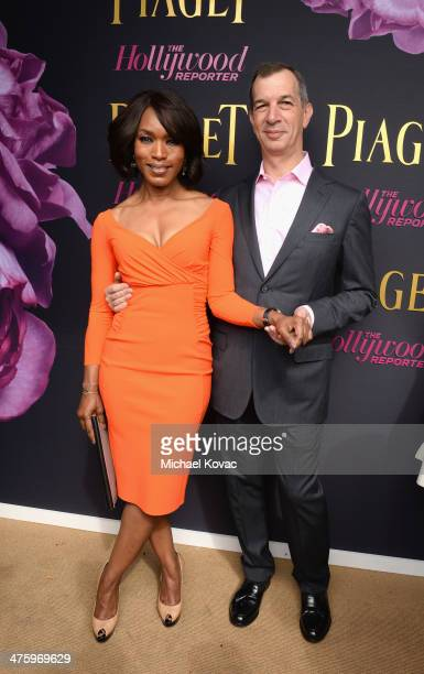 Actress Angela Bassett wearing Piaget and CEO of Piaget Philippe LeopoldMetzger pose in the Piaget Lounge during the 2014 Film Independent Spirit...