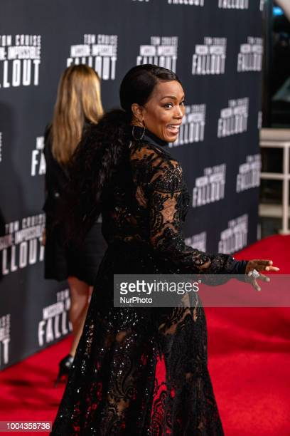 Actress Angela Bassett who plays quotErika Sloanequot in Mission Impossible Fallout walks the red carpet of the US premiere at the Smithsonian...