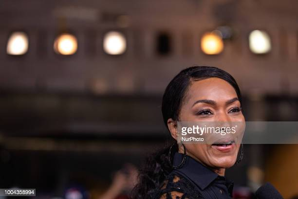Actress Angela Bassett who plays quotErika Sloanequot in Mission Impossible Fallout talks to reporters on the red carpet of the US premiere at the...