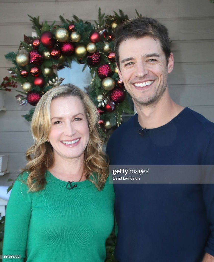 Actress Angela Kinsey (L) and husband actor Joshua Snyder visit Hallmark's 'Home & Family' at Universal Studios Hollywood on December 7, 2017 in Universal City, California.