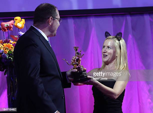 Actress Angela Kinsey presents the Lifetime Achievement Award to Bryan Bundesen during The Friskies 2013 at Arena NYC on October 15 2013 in New York...