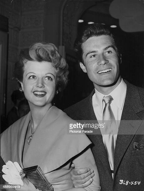 Actress Angela Lansbury and her husband Peter Shaw attending the premiere of the movie 'The Glass Menagerie' 1950