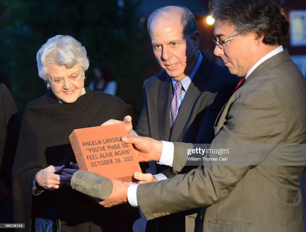 Actress Angela Lansbury is presented with a commemorative brick to be installed in the walkway by Jed Bernstein, Producing Director of the Bucks County Playhouse and Hugh Marshall October 28, 2013 at the Bucks County Playhouse in New Hope, Pennsylvania. Lansbury, five-time Tony Award winning actress is the first inductee of the Bucks County Playhouse's Hall of Fame.