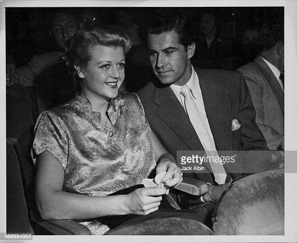 Actress Angela Lansbury with her husband Peter Shaw attending the premiere of the film 'Flying Leathernecks' 1951