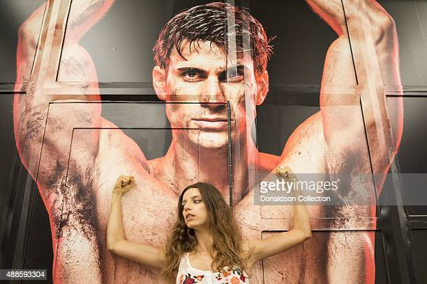 Actress Angela Sarafyan poses for a portrait in front of a large mural on Hollywood Boulevard on August 28 2015 in Los Angeles California