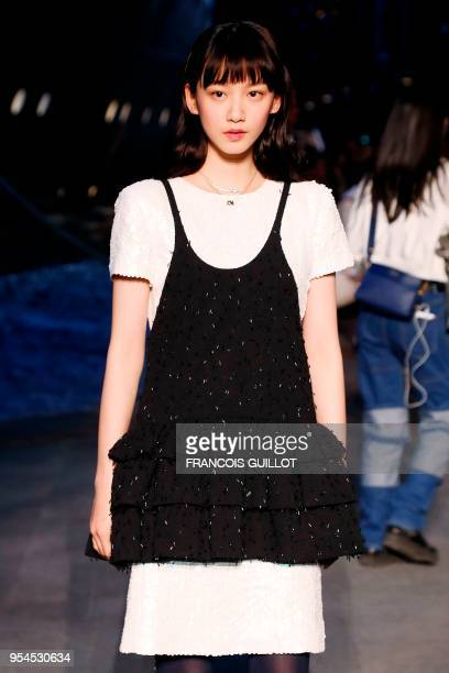 Actress Angela Yuen poses during a photocall before the Chanel Croisiere fashion show on May 3 2018 at the Grand Palais in Paris