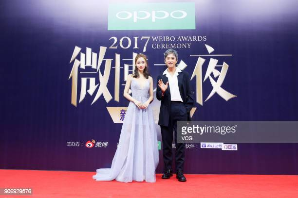 Actress Angelababy and actor Deng Chao pose on the red carpet of 2017 Weibo Awards Ceremony at National Aquatics Center on January 18 2018 in Beijing...