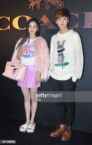 Actress Angelababy and EXO's Lu Han attend the opening ceremony for the Coach store at Shin Kong Place on January 6 2015 in Beijing China