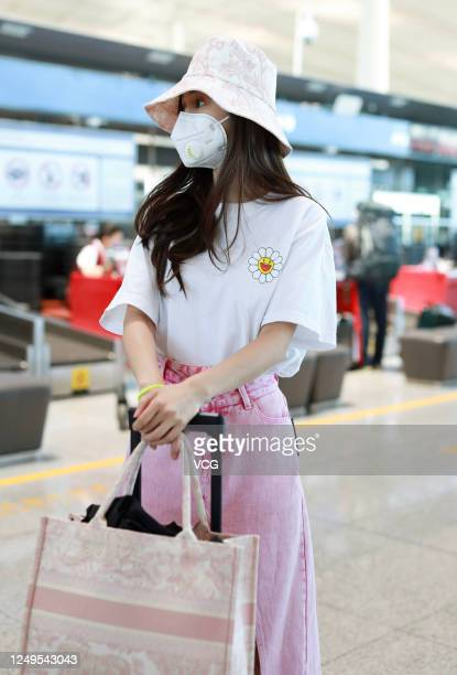 Actress Angelababy arrives at an airport on June 14 2020 in Beijing China
