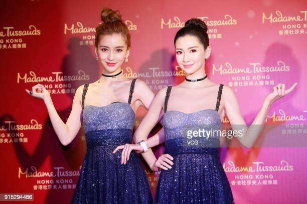 Actress Angelababy poses with her wax figure during the unveiling ceremony at Madame Tussauds on February 7 2018 in Hong Kong China