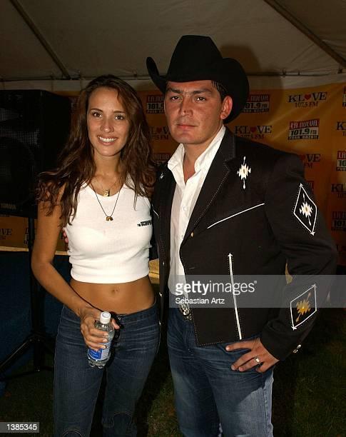 Actress Angelica Castro and singer Jose Manuel Figuero pose backstage at Fiesta de Independencia 2002 on September 15 2002 in El Monte California