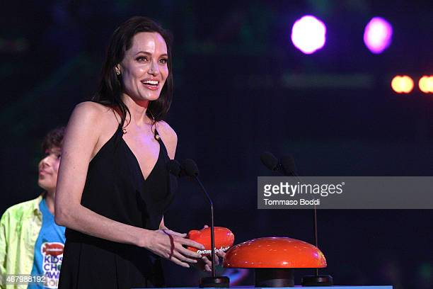Actress Angelina Jolie accepts award for Favorite Villain for 'Maleficent' onstage during the Nickelodeon's 28th Annual Kids' Choice Awards held at...