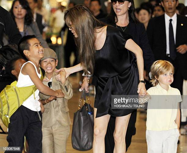 US actress Angelina Jolie accompanied by her children Maddox Zahara Pax and Shiloh arrives at the Narita International Airport on July 26 2010 Jolie...