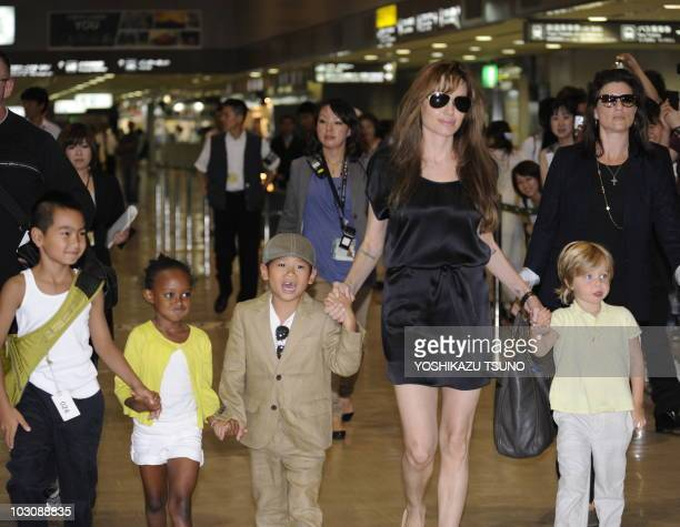 Actress Angelina Jolie , accompanied by her children Maddox , Zahara , Pax and Shiloh , arrives at the Narita International Airport on July 26, 2010....
