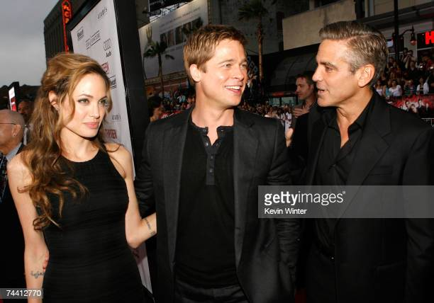 Actress Angelina Jolie actors Brad Pitt and George Clooney arrive to the Warner Bros premiere of the film 'Ocean's 13' at Grauman's Chinese Theatre...