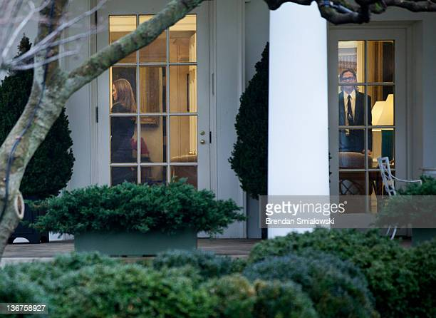 Actress Angelina Jolie and actor Brad Pitt are seen the Oval Office of the White House after a meeting January 11 2012 in Washington DC Angelina...