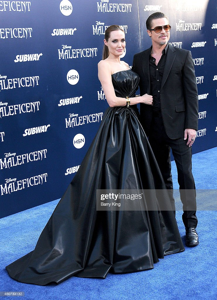 Actress Angelina Jolie and actor Brad Pitt arrive at the Los Angeles premiere of 'Maleficent' on May 28, 2014 at the El Capitan Theatre in Hollywood, California.