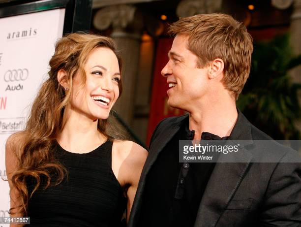 Actress Angelina Jolie and actor Brad Pitt arrive to the Warner Bros premiere of the film 'Ocean's 13' at Grauman's Chinese Theatre on June 5 2007 in...