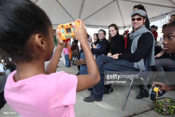 "Actress Angelina Jolie and Actor Brad Pitt attend The Childrens Health Fund ""Raise Awareness"" event at the Martin Luther King Jr. Charter School on..."