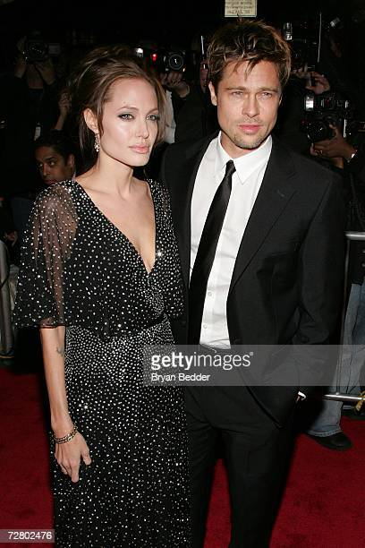 Actress Angelina Jolie and actor Brad Pitt attend the World Premiere of 'The Good Shepherd' presented by Universal Pictures at the Ziegfeld Theatre...
