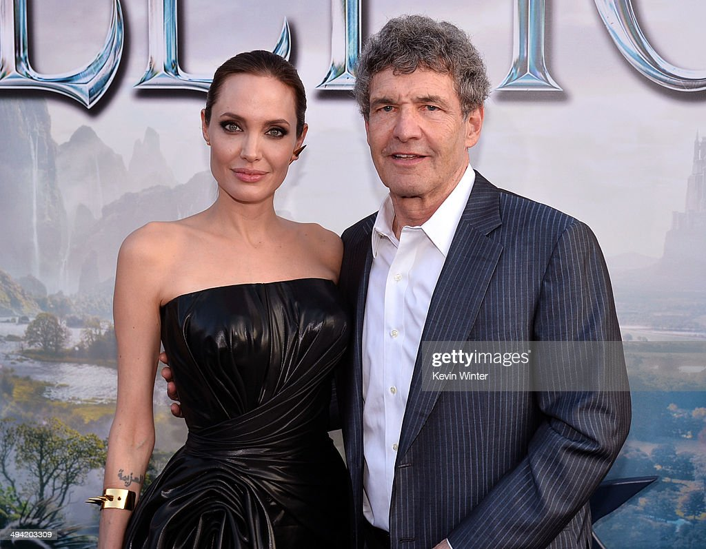 Actress Angelina Jolie (L) and Chairman of the Walt Disney Studios Alan Horn attends the World Premiere of Disney's 'Maleficent' at the El Capitan Theatre on May 28, 2014 in Hollywood, California.