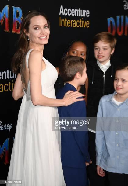 US actress Angelina Jolie and children Knox JoliePitt Zahara Marley JoliePitt Shiloh JoliePitt and Vivienne Marcheline JoliePitt arrive for the world...
